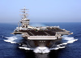 US Navy aircraft carrier in the Arabian Sea displaying signal fl