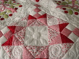 ^ Red and white quilt
