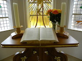 Bible-candles-flowers-altar-window