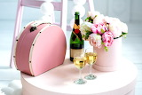 Flowers, table, pink, handbag, bottle, glasses, gifts, suitcase,