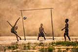 Soccer-sport-football-boys-children-playing-nature