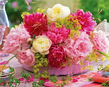 Bouquet of peonies in a pink basket