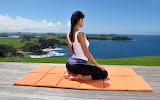 Girl-doing-yoga-over-hawaiian-seashore-mat-9Oc9