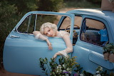 girl in a blue car