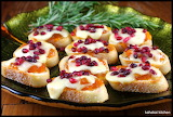 ^ Bruschetta Topped with Apricot, Melted Brie, and Pomegranate S
