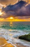 Sunset over turqoise ocean