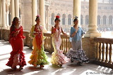 Ladies at the Feria, Seville by Michelle Chaplow