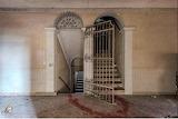 Gated interior door and stairs forgotten Villa Cammeo