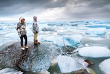 Extremely-beautiful-tourists-stand-on-the-massive-icebergs-in-la