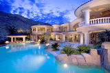 Luxury white traditional style mountainside villa and pool