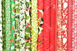 Rolls-of-colorful-christmas-fabric