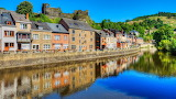 Houses on Ourthe River with Castle ruins in La-Roche-en-Ardenne,