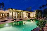 modern villa and illuminated aqua pool