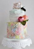 Watercolor and ruffles wedding cake