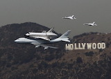 Space Shuttle Endeavour is escorted by two F-18 jets