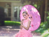 Girl in a pink dress with pink parasol