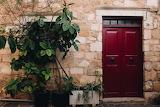 ^ Red door of house in Greece