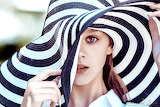 gril in stripped hat