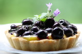 ^ Blueberry Tartlets with Lime Curd