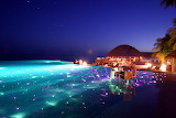 Infinity-Pool-with-dining-and-LED-lights-Huvafen-Fushi-Resort-in