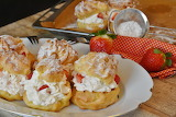 ^ Cream Puffs Stuffed with Whipped Cream and Strawberries