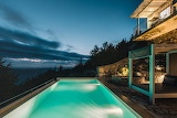 Luxury seaview villa, terrace and pool at night