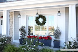 ^ Christmas front porch planters