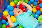 Baby, cheerful, colored balls, game