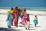 People, women, girls, colorful traditional dresses, beach, ocean