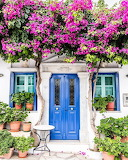 ^ Purple Bougainvillea Blue Door Greece
