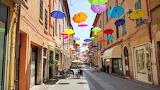 Ferrara, town, old street, bars, shops, hanging umbrellas