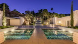Modern stone house and garden at night in Ibiza