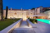 Beautiful Mediterranean stone mansion, garden and pool at night