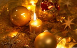 Gold candle and ornaments