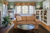 Loveseat and White Bookcases Room