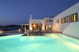 Beautiful white seaview villa with pool at night