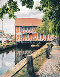 Red building on canal Wismar Germany