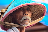 Asian man with beard, mustache and hat
