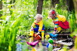 ^ Children playing in a puddle