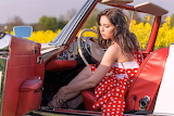 girl in red convertible car