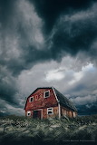 Storm clouds over old barn
