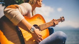 Female-guitar-player-on-acoustic-guitar