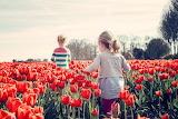 Girls-tulips-field
