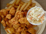 ^ Fried seafood with fries and slaw