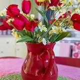 ^ Red vase with tulips