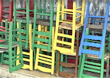 Chairs stacked outside cafe Greece