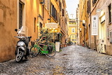 Motorcycle and bicycles outside Ristorante and Wine Bar Rome Ita