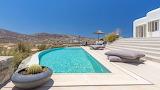 Greek island luxury white mountain view villa and pool