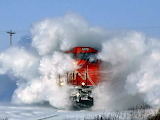 Train Plowing Through The Snow