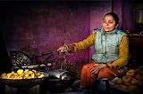 Woman-in-colorful-dress-cooking-in-streeet-shop-in-kathmandu-nep
